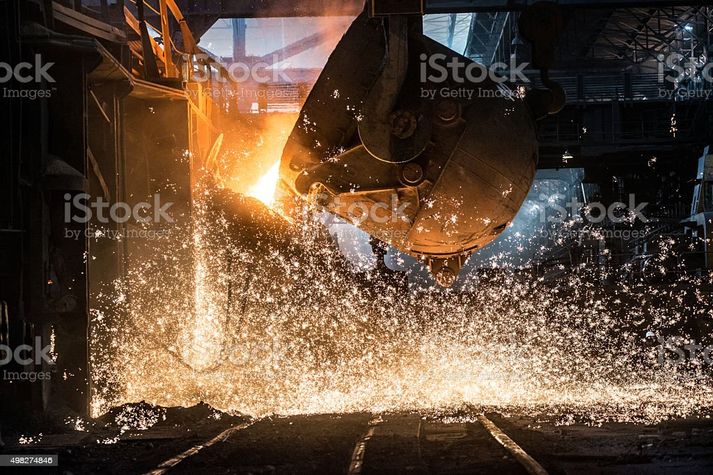 Pouring of liquid metal in open-hearth furnace stock photo