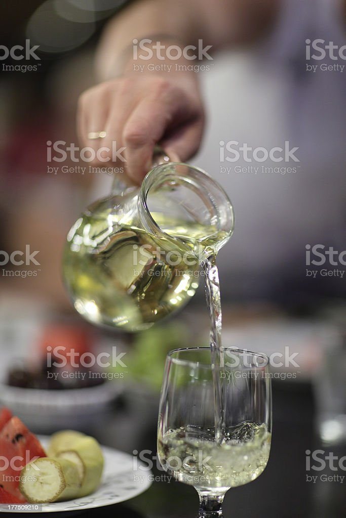 Pouring of white wine royalty-free stock photo