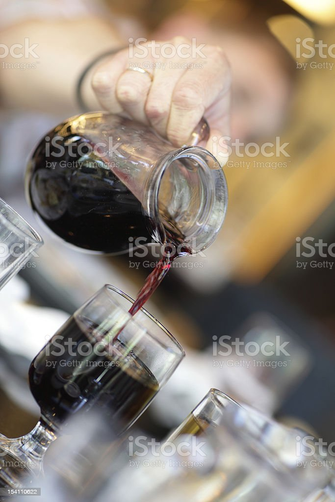 Pouring of wine royalty-free stock photo