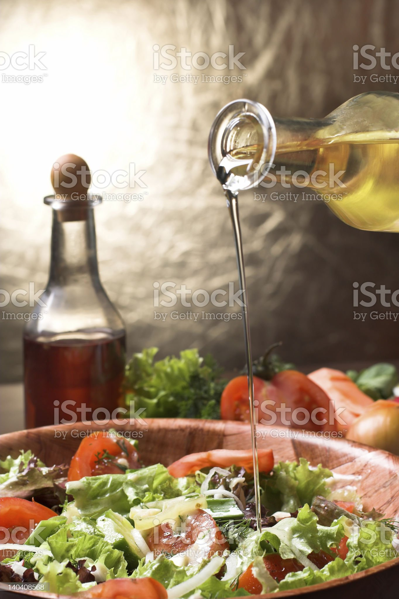 Pouring oil on a bowl of salad royalty-free stock photo