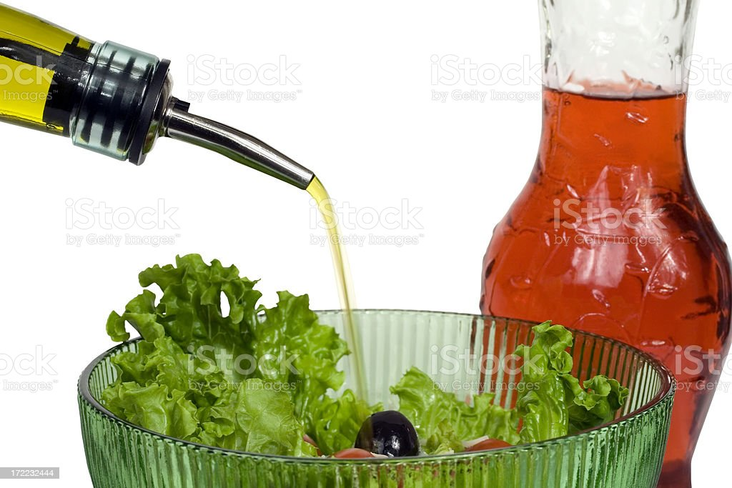 Pouring oil on a salad royalty-free stock photo