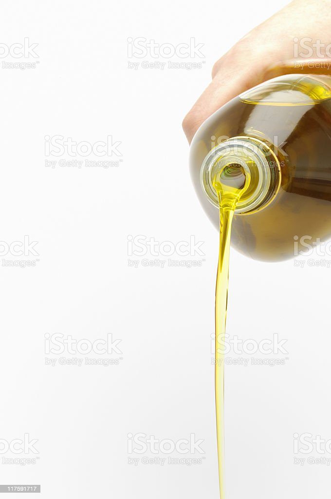 Pouring oil stock photo