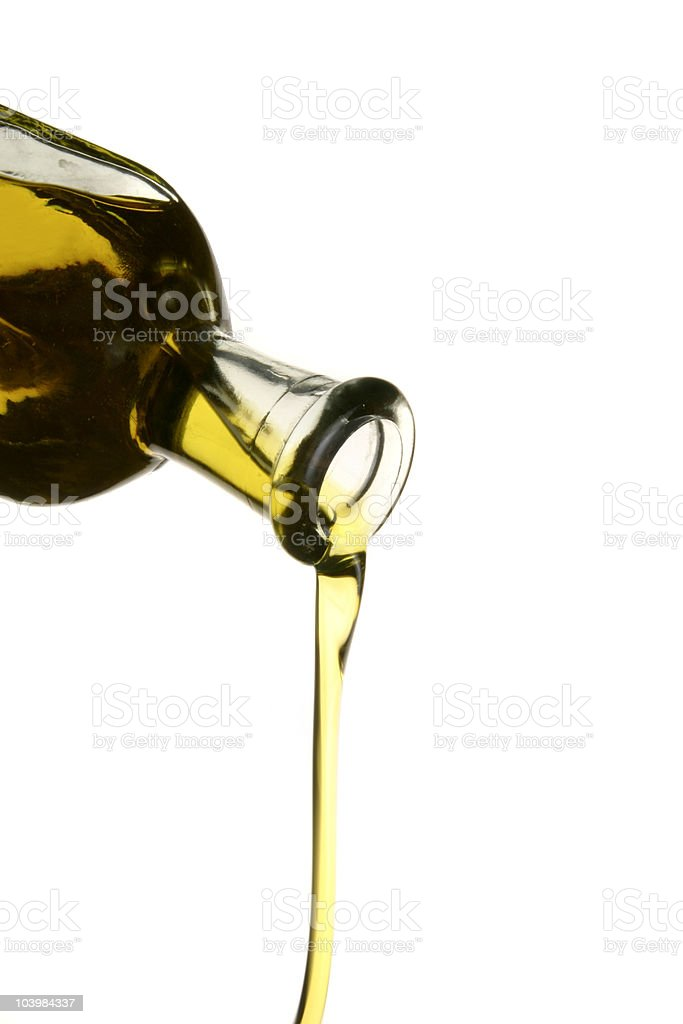 pouring olive oil from a bottle royalty-free stock photo