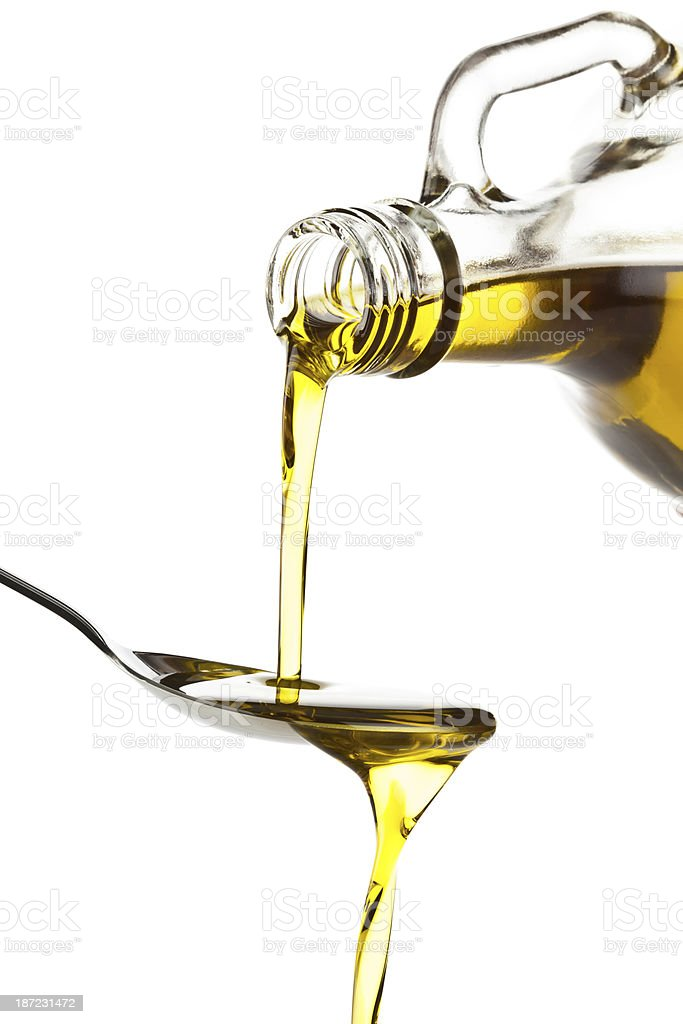 Pouring Olive Oil royalty-free stock photo