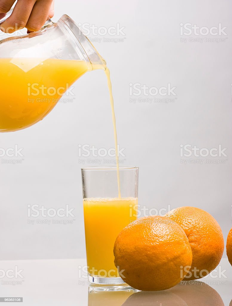 Pouring Orange Juice royalty-free stock photo