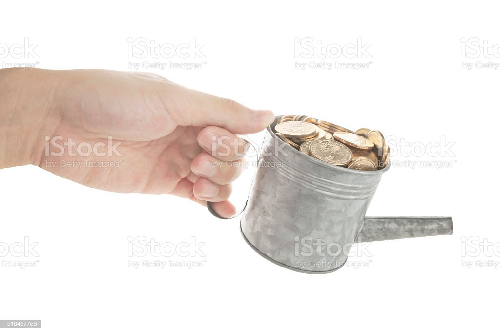 Pouring out coin stock photo