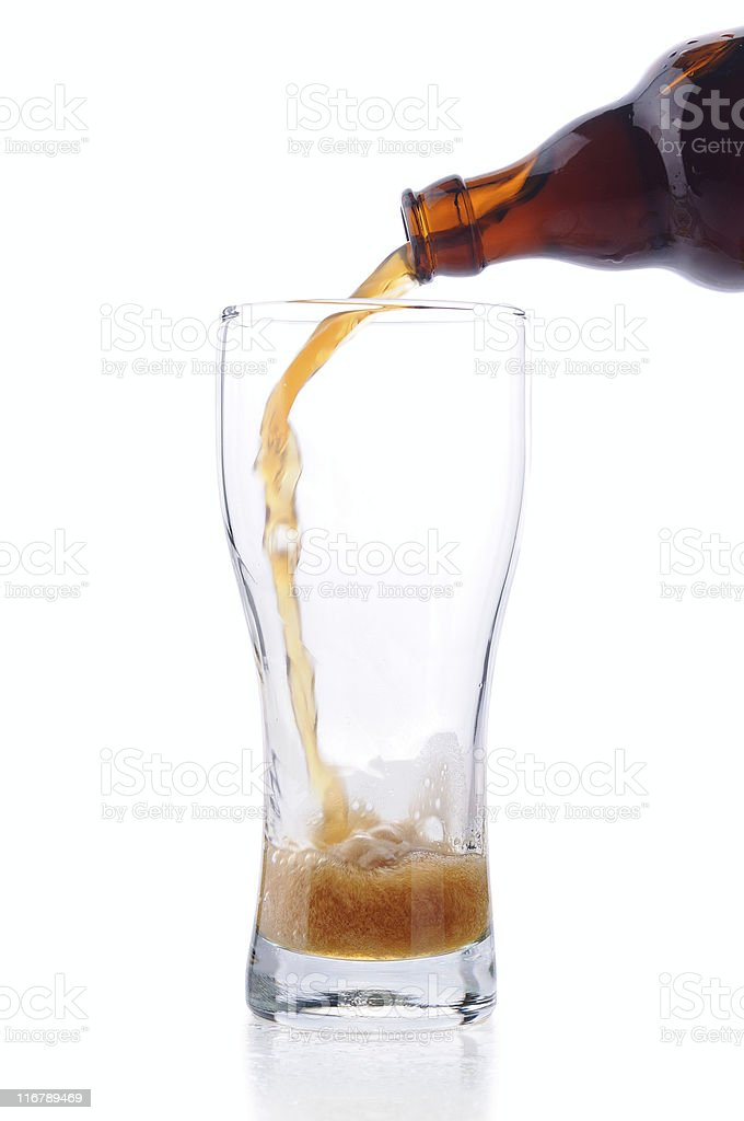 Pouring out dark beer stock photo