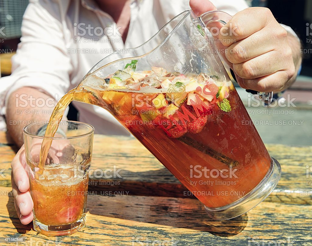 Pouring Pimm's From A Jug stock photo