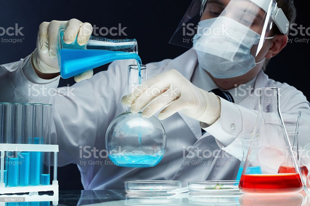 Pouring reagents stock photo