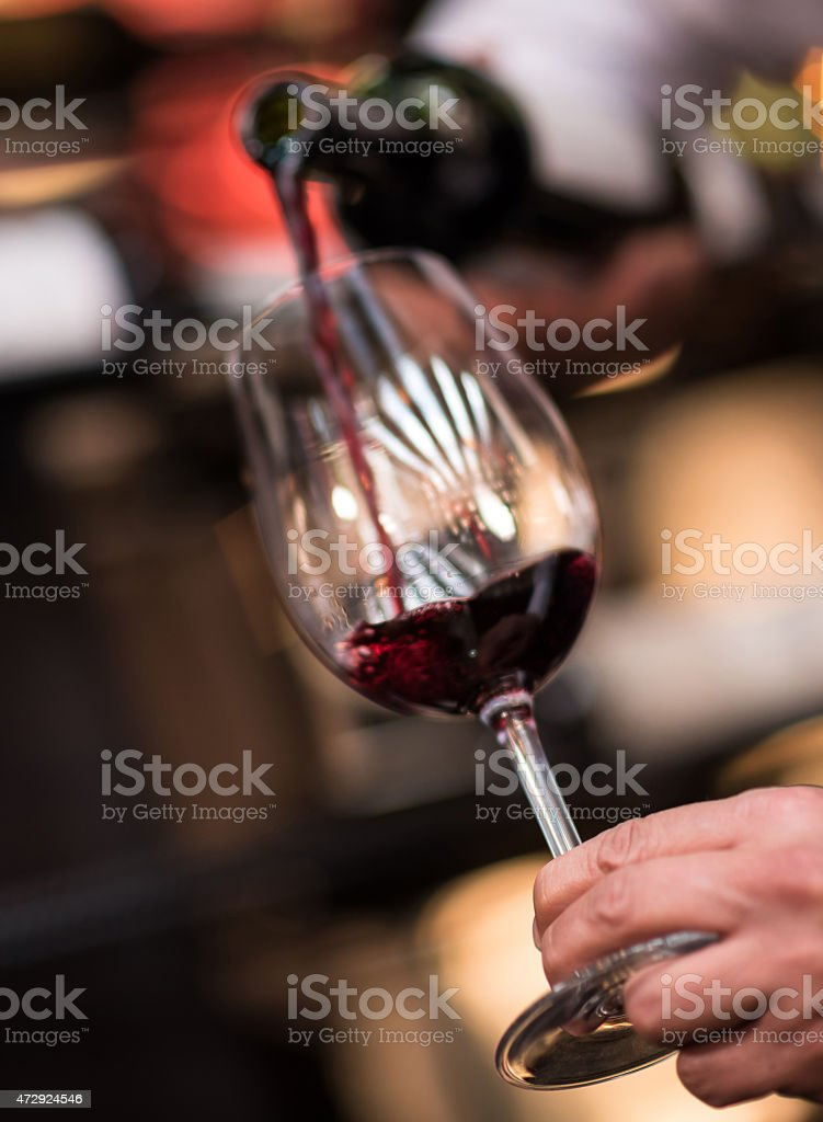 Pouring red wine at a winetaste stock photo