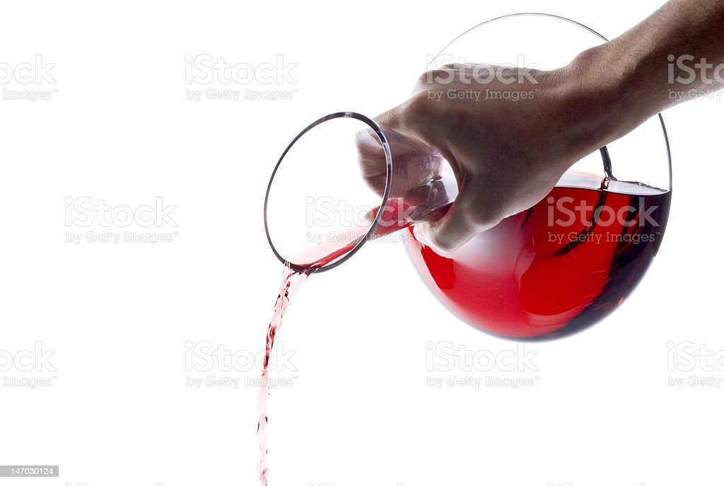 Pouring Red Wine from a Decanter royalty-free stock photo