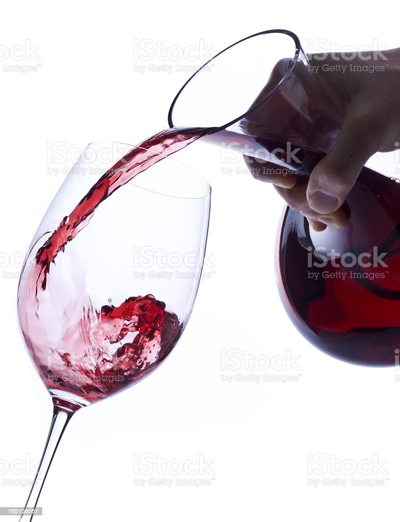 Pouring Red Wine from  Decanter into a Glass stock photo