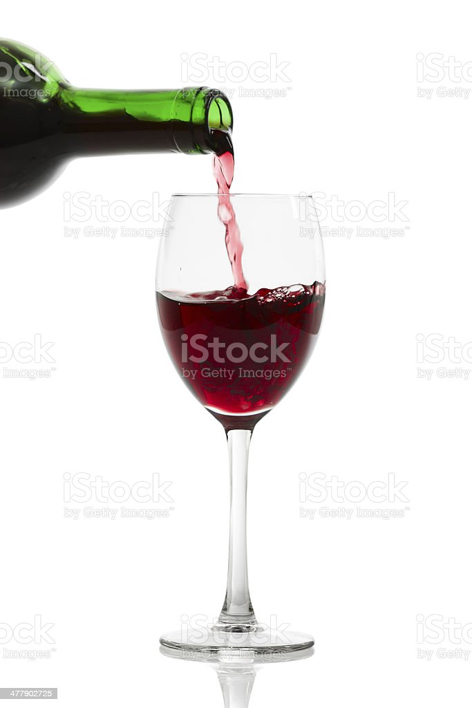 Pouring Red Wine. Isolated with clipping path. royalty-free stock photo