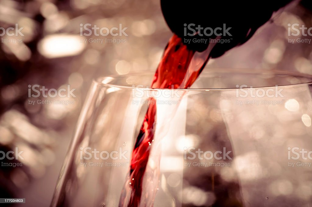 Pouring red wine royalty-free stock photo