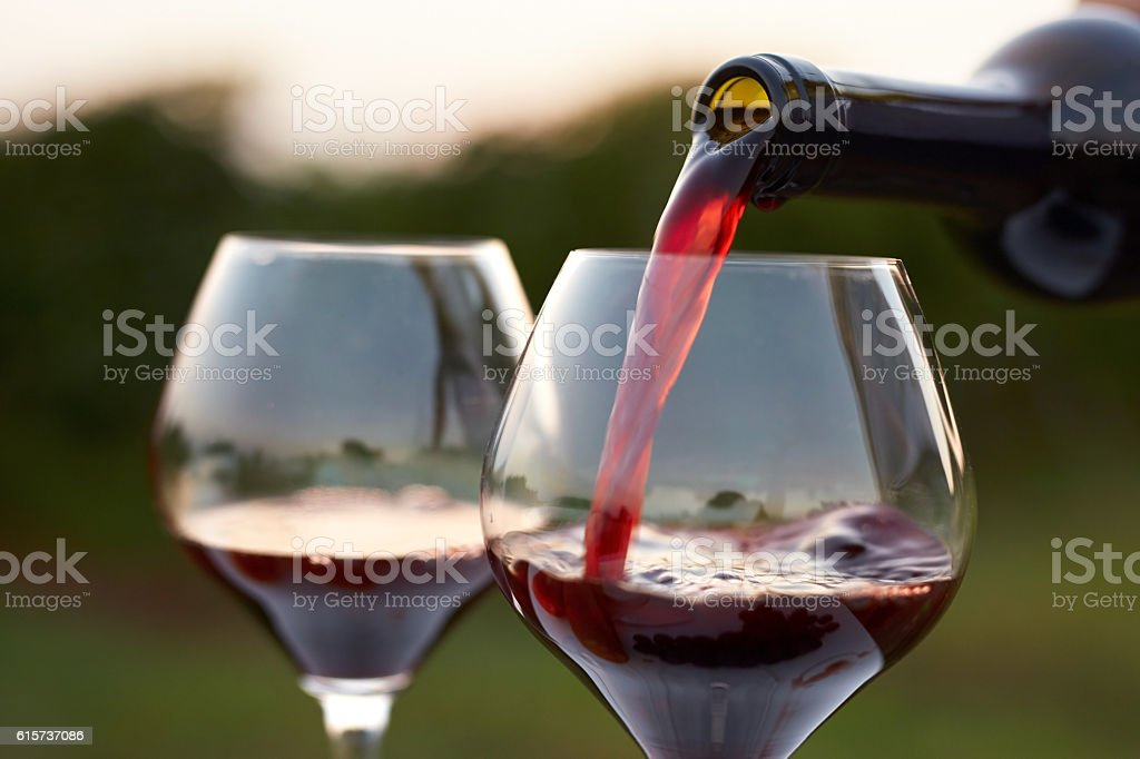 Pouring red wine stock photo