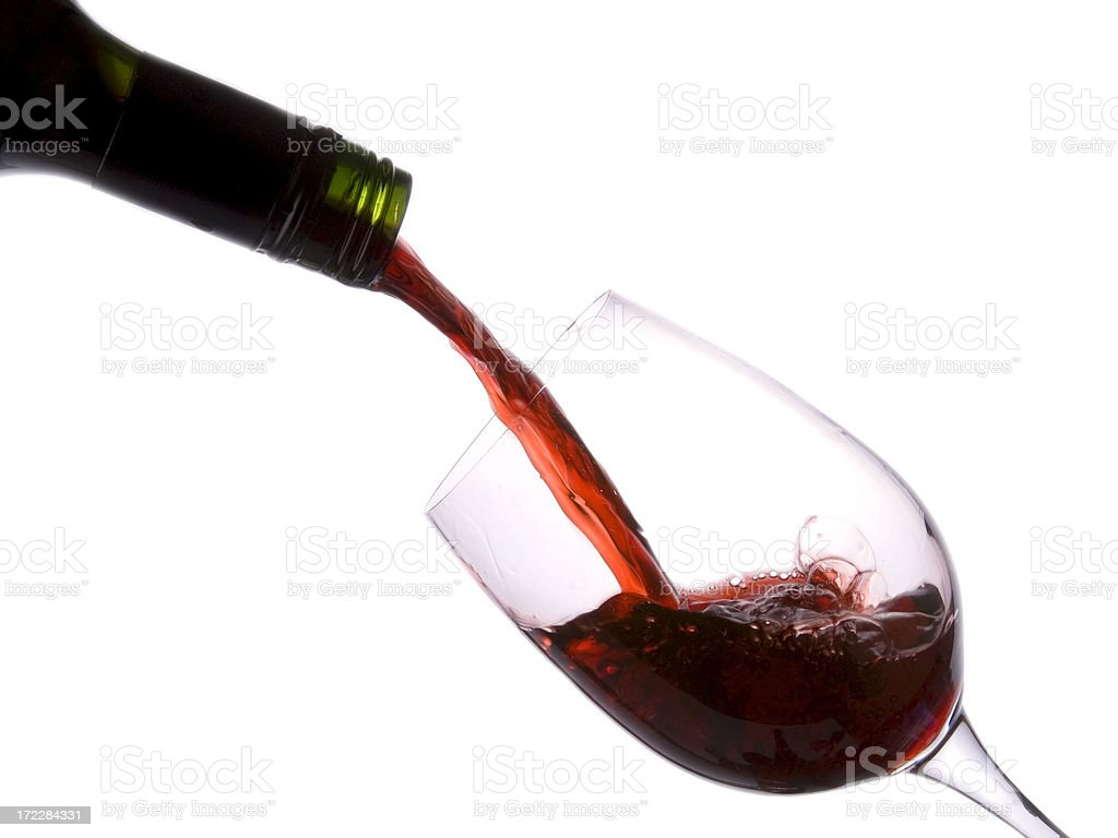 Pouring red wine sequence fourth image royalty-free stock photo