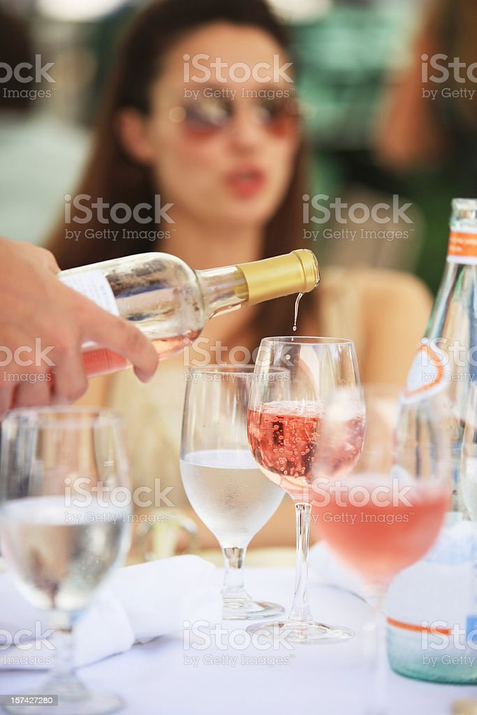 Pouring Rose Wine stock photo