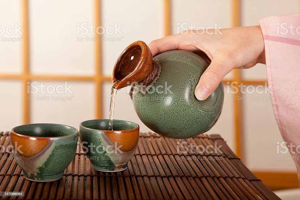 Pouring sake stock photo