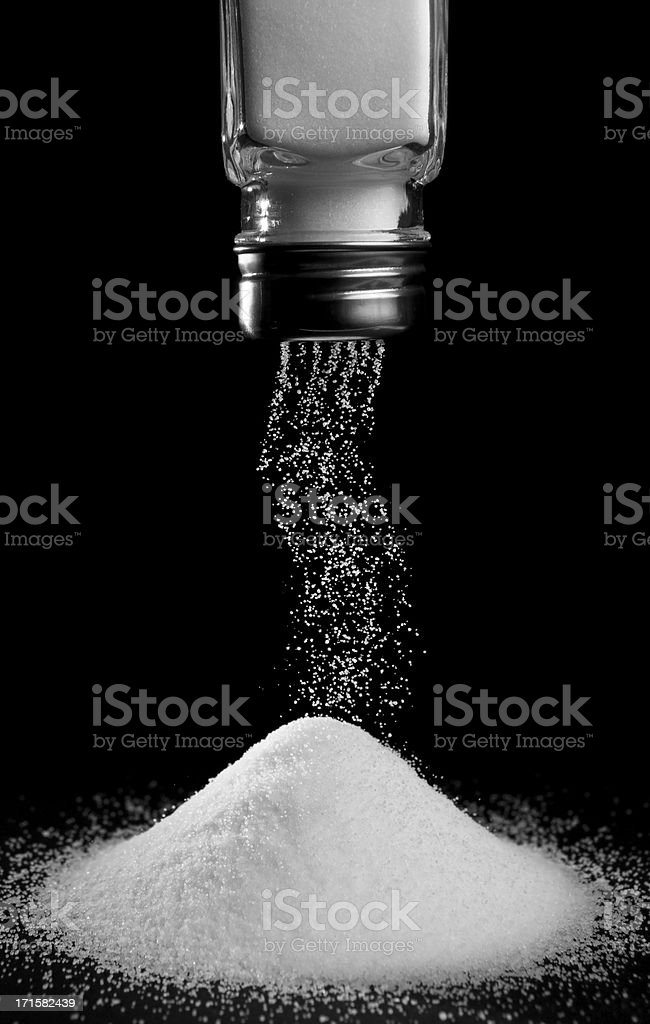 pouring salt stock photo