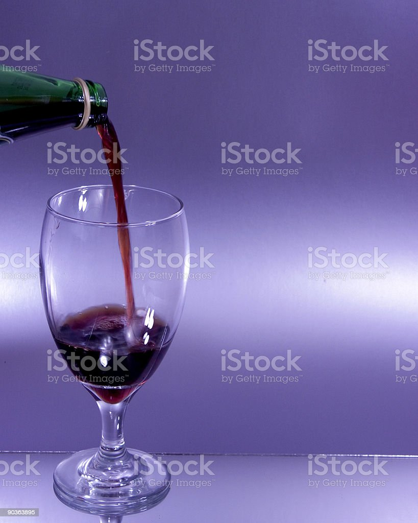 Pouring some wine royalty-free stock photo