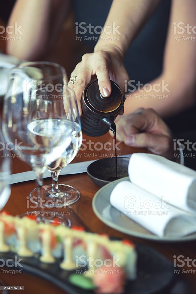 Pouring soy sauce stock photo