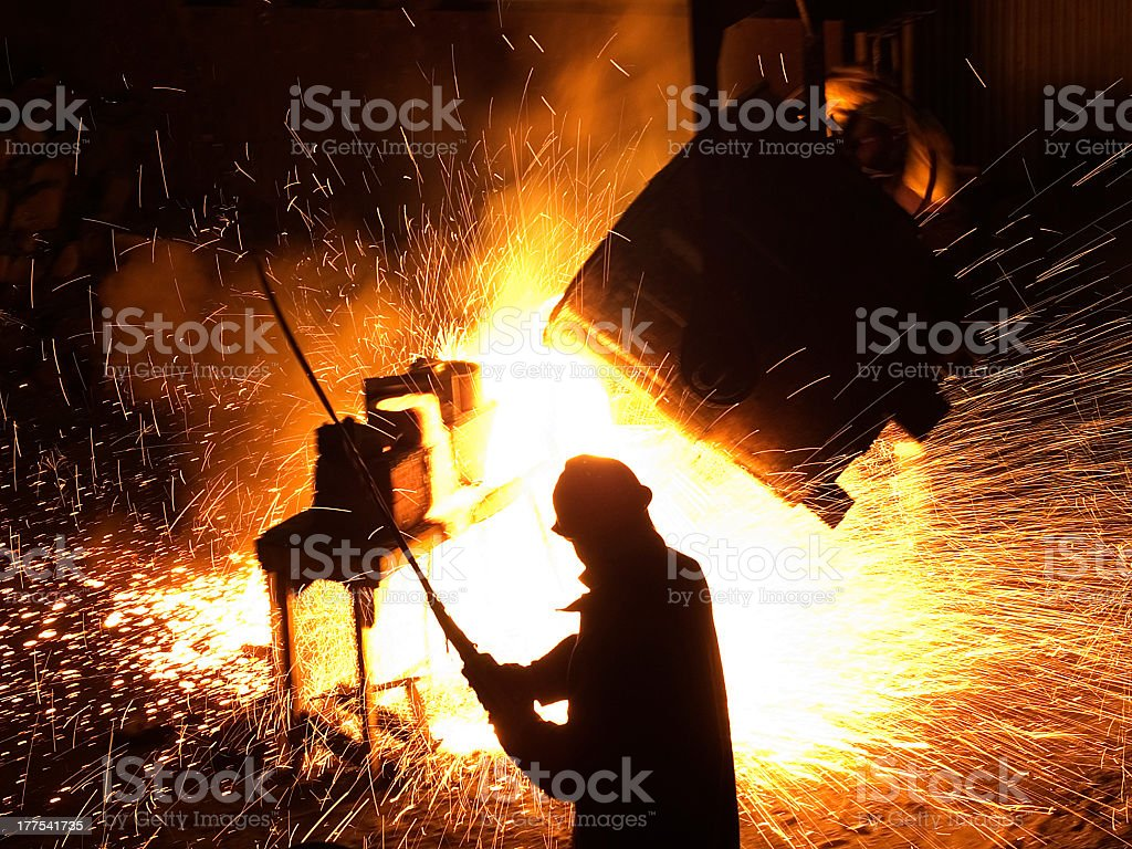 Pouring steel stock photo