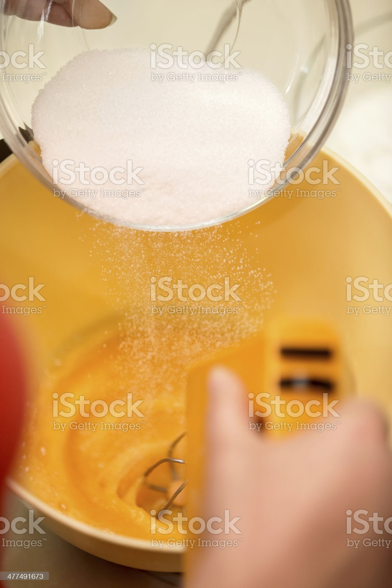 Pouring sugar into bowl royalty-free stock photo