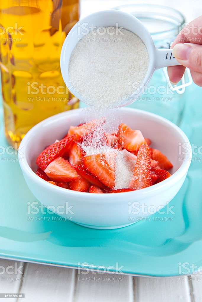 Pouring Sugar on Berries royalty-free stock photo