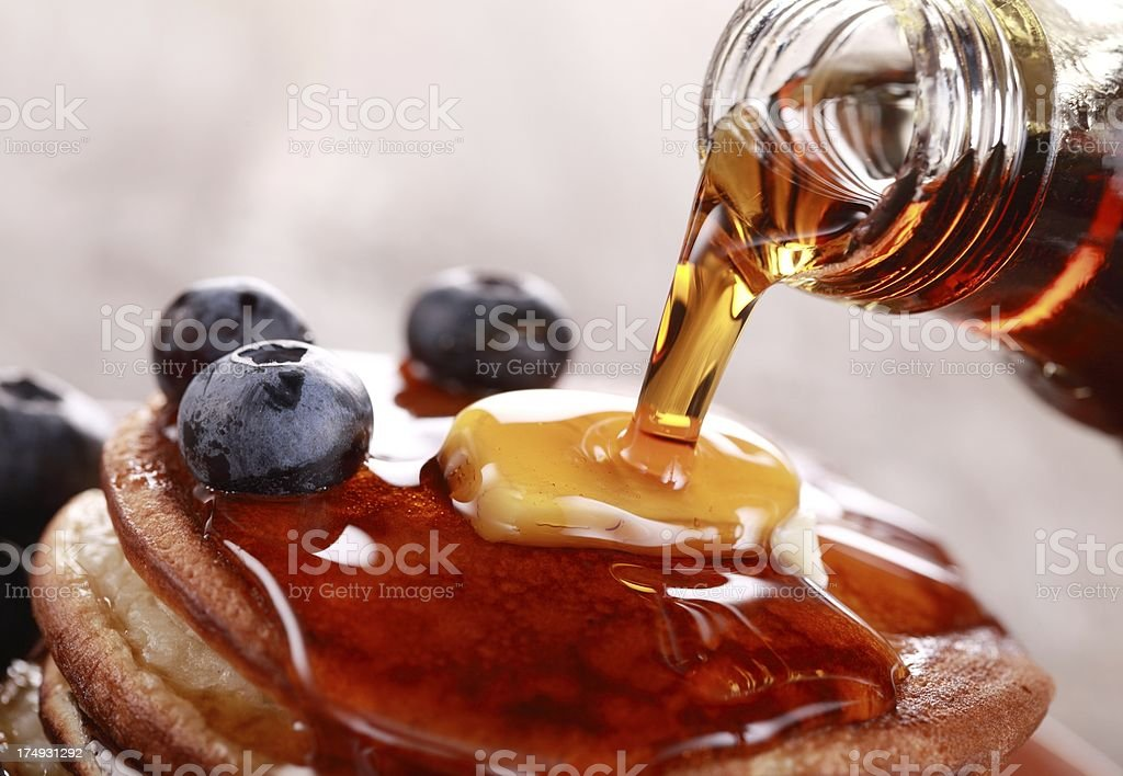 Pouring syrup stock photo