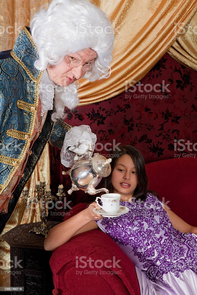 Pouring tea for the Lady stock photo
