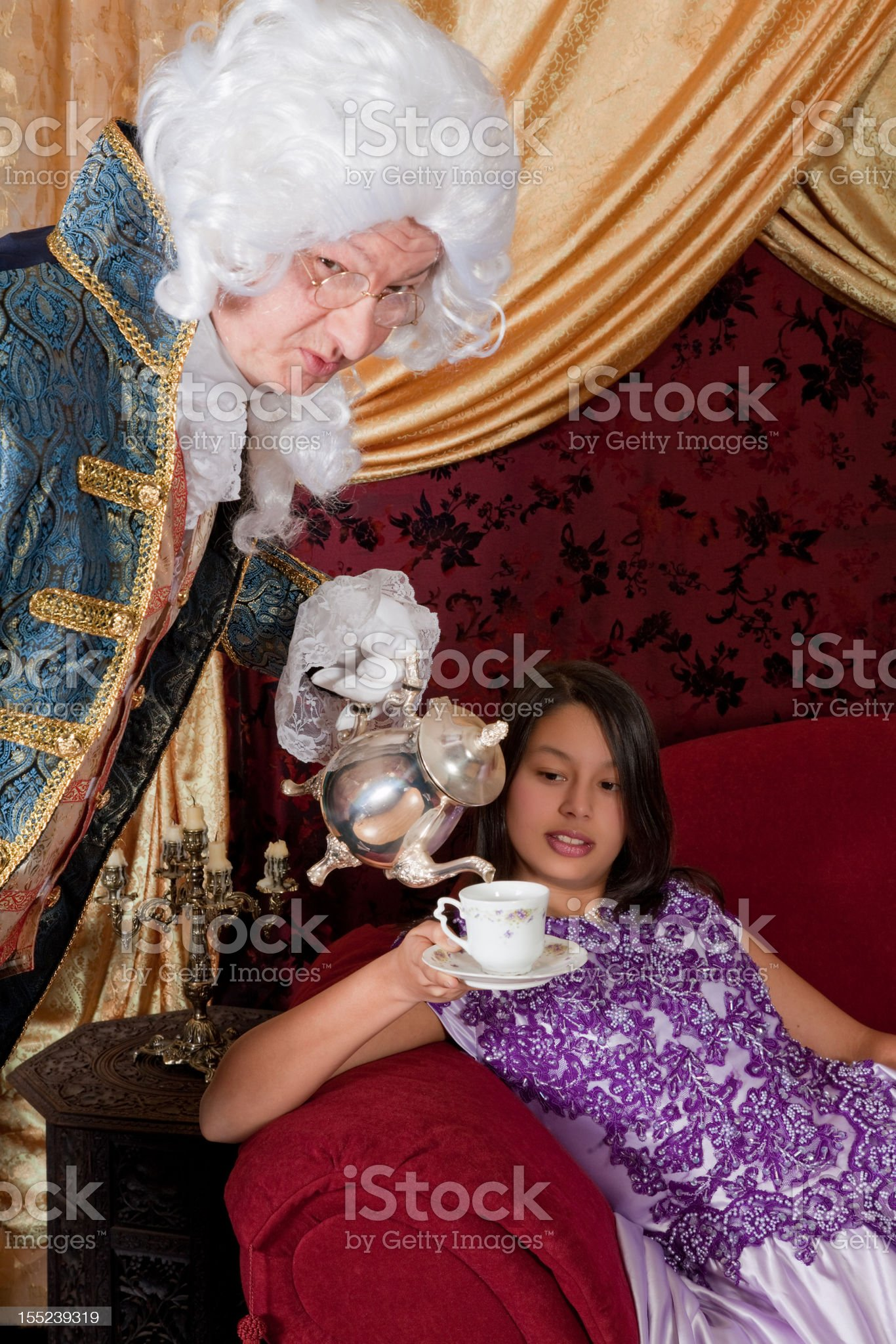 Pouring tea for the Lady royalty-free stock photo