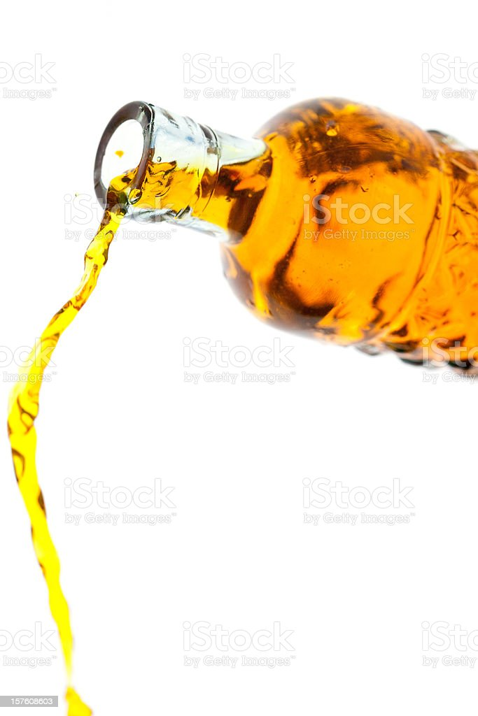 Pouring The Amber Liquid royalty-free stock photo