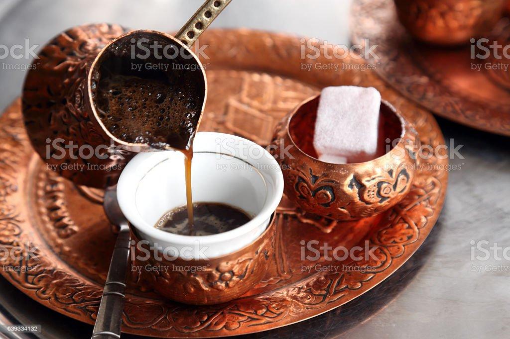 Pouring turkish coffee stock photo