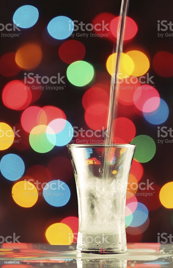 Pouring  vodka in to a shot glass royalty-free stock photo