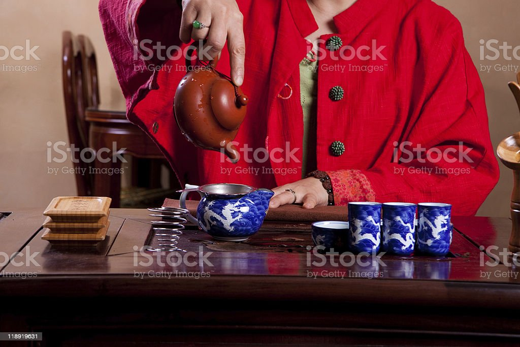 Pouring water for tea royalty-free stock photo
