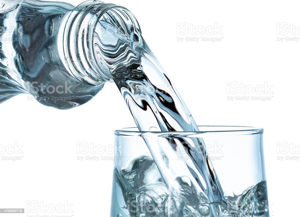 Pouring water from bottle stock photo