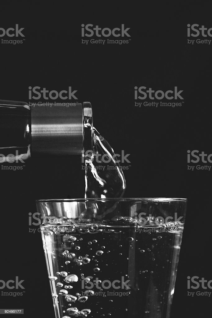 Pouring Water - highcontrast black and white stock photo