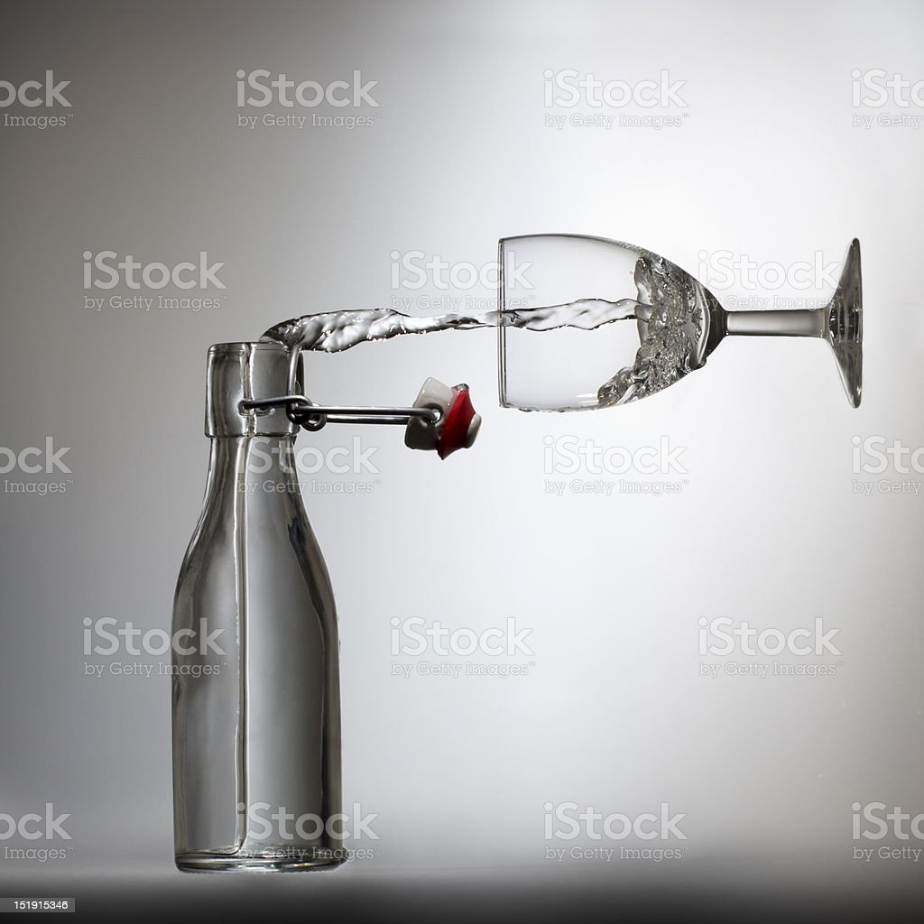 Pouring water in a glass, illusion stock photo