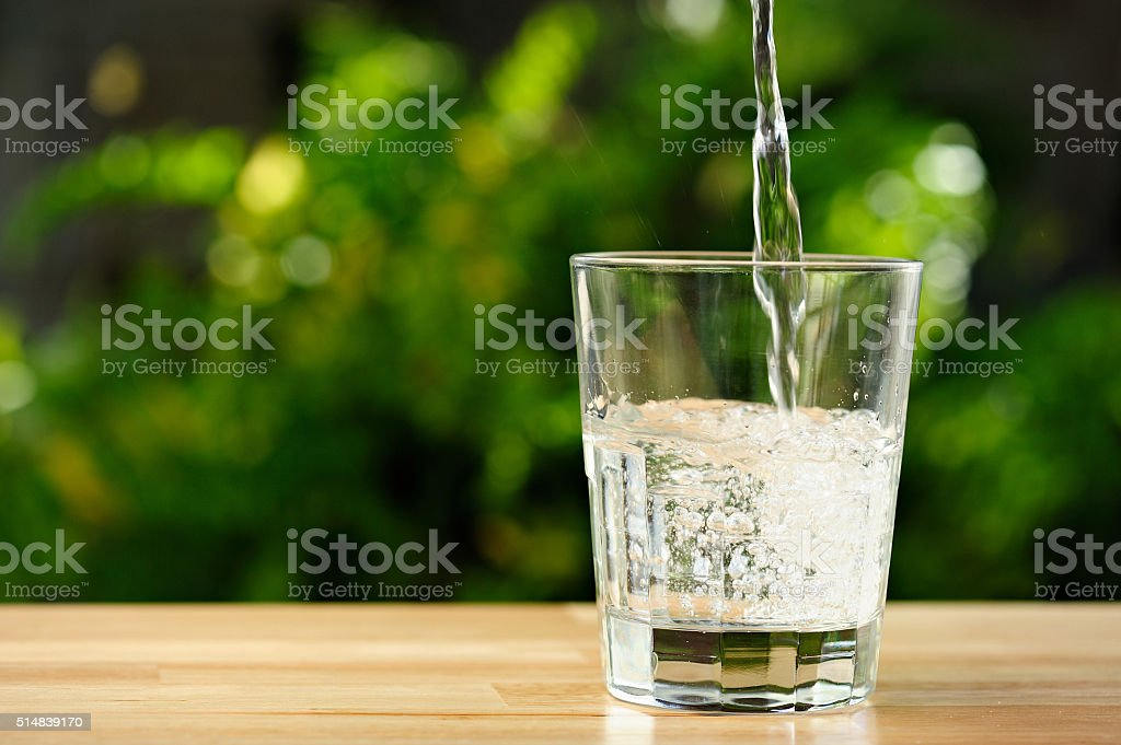 pouring water in garden stock photo