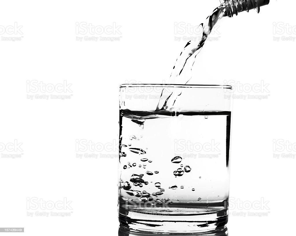 Pouring water into a glass on white royalty-free stock photo