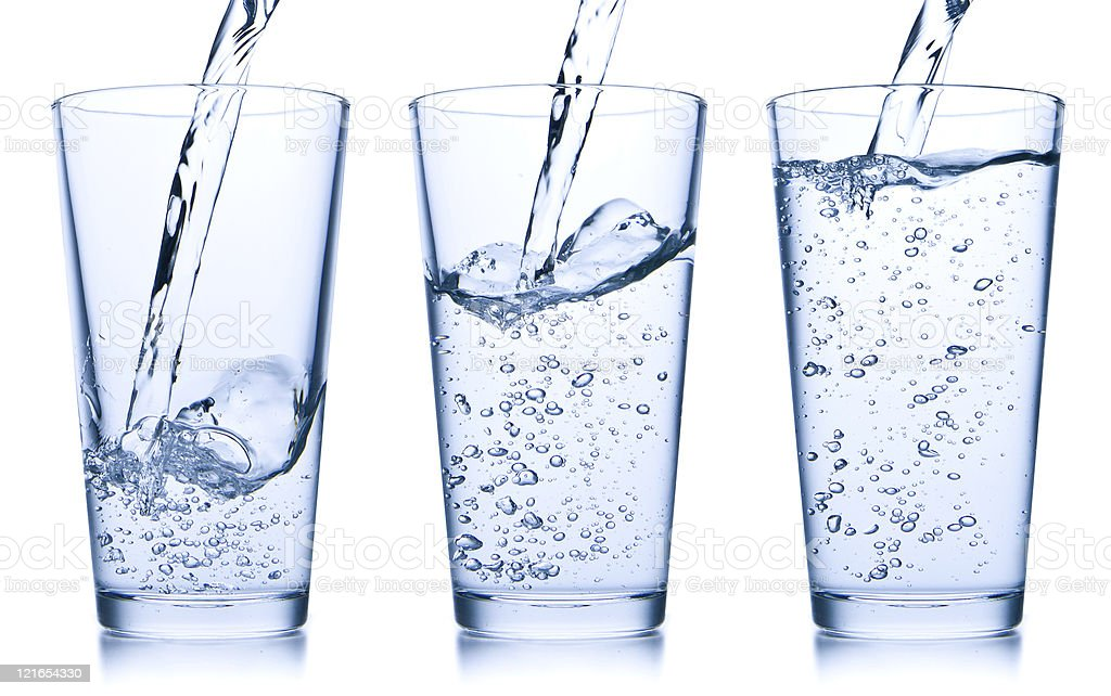 pouring water into glass royalty-free stock photo