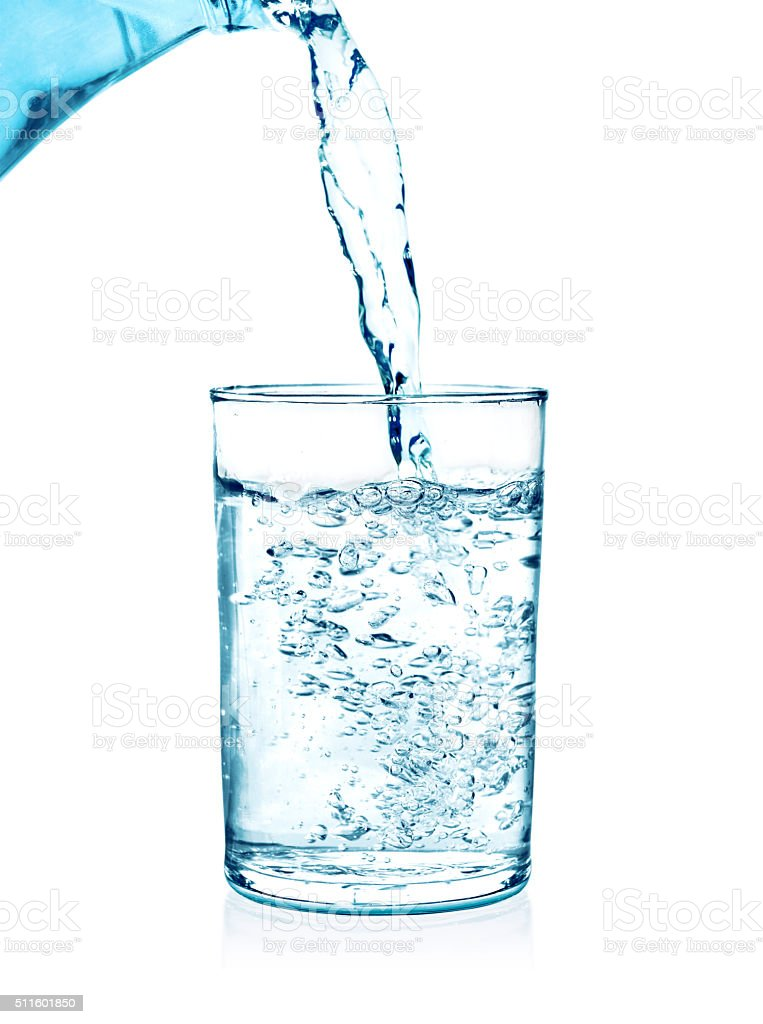 pouring water on a glass on white stock photo