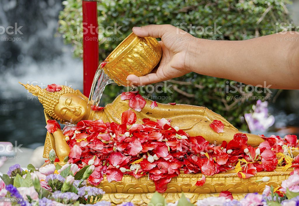 Pouring water over Buddha stock photo