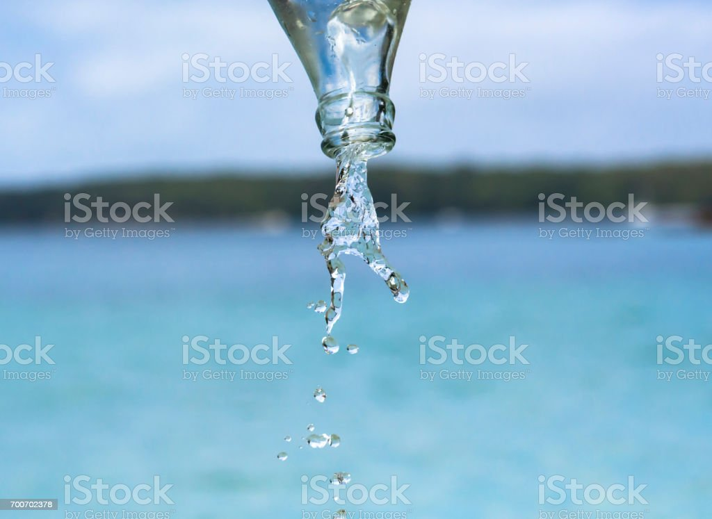 Pouring water stock photo
