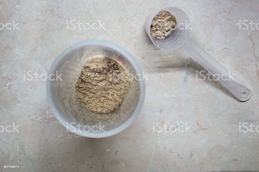 Pouring Whey Protein Powder in a Shaker/Bottle royalty-free stock photo