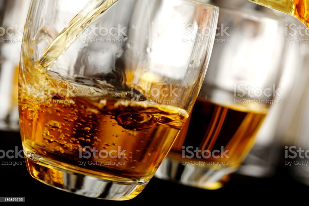 Pouring whiskey in a glass royalty-free stock photo