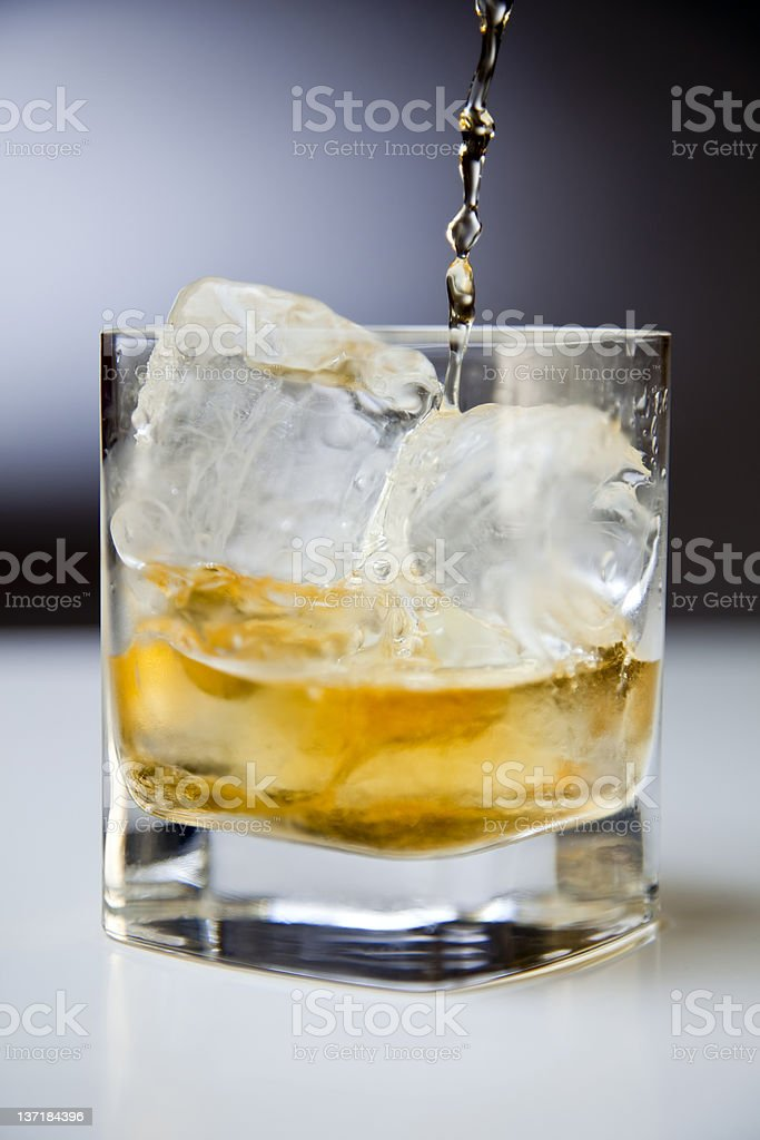 Pouring whiskey royalty-free stock photo