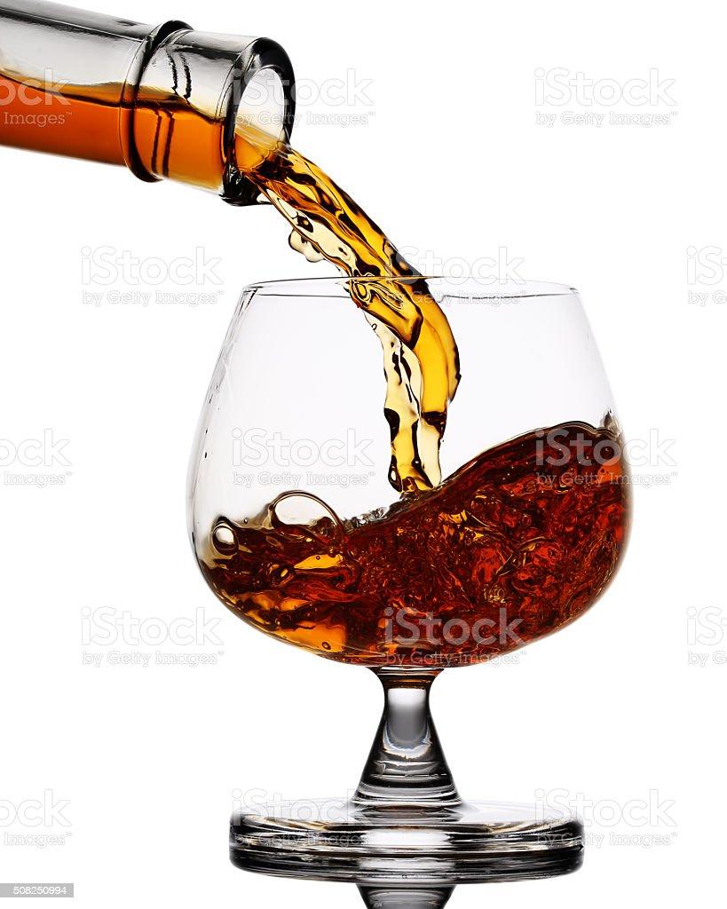 Pouring whiskey stock photo