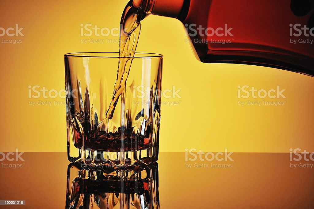 Pouring whisky royalty-free stock photo