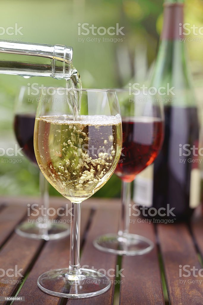 Pouring White Wine in Glass royalty-free stock photo